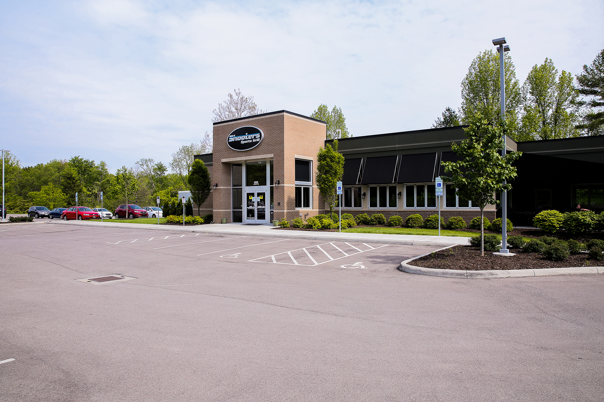 external view of the Shooters building and parking lot